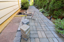 Stone Pavers And Tools For Side Yard Landscaping