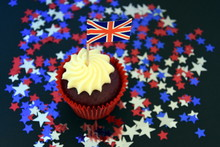 UK Celebration Cake, Party Food With Red, White And Blue Cupcake And British Flag.  Celebration, Patriotism And Holidays Concept - Close Up Of Glazed Muffin Decorated With British Flag