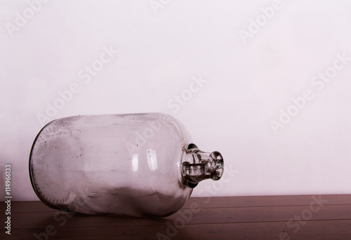 Tela Clear glass demijohn against a light background