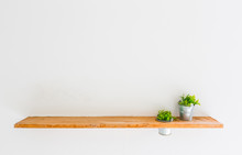 Wooden Shelf On White Wall Wit...