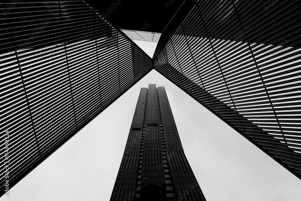 Fototapeta Melbourne CBD architecture - metal scultpture and skyscraper in black and white