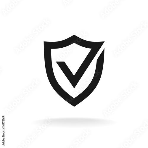 Fotografie, Obraz  Shield with check mark black icon. Protection approve sign.