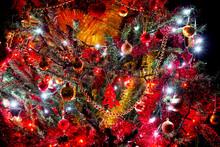 Detail Of Illuminated Christmas Tree Isolated On A Black Background
