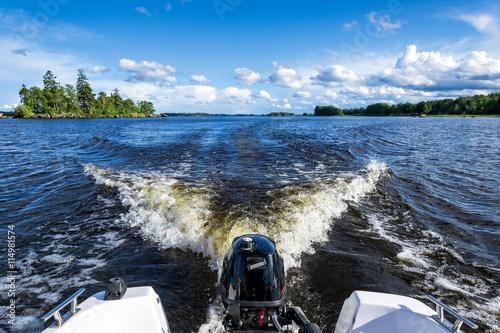 Boat travelling on Swedish lake