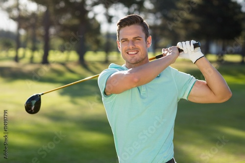 Photo  Portrait of handsome man with golf club