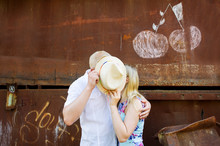 Couple In Love Kissing Behind The Hat
