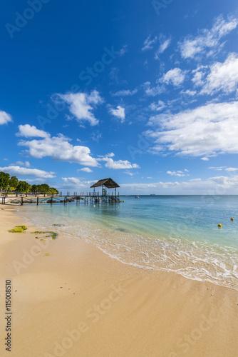 fototapeta na ścianę Mauritius beach thatch jetty. Tropical Mauritius island water & beach resort, Turtle Bay - Balaclava