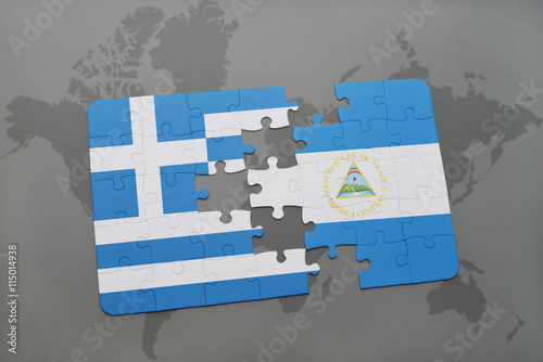 puzzle with the national flag of greece and nicaragua on a ...