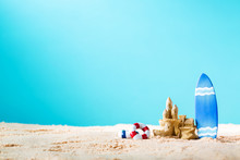 Summer Theme With Surfboard And Sand Castle