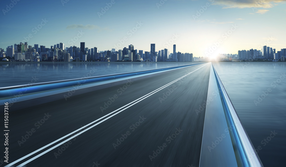 Fototapety, obrazy: Highway overpass motion blur with city skyline background . cold mood .