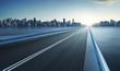 Leinwanddruck Bild - Highway overpass motion blur with city skyline background . cold mood .