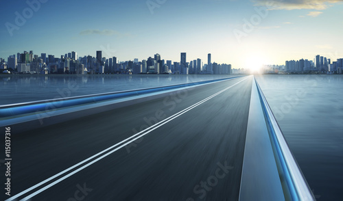 Highway overpass motion blur with city skyline background . cold mood . - 115037316
