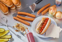 Making Hot Dogs In The Stainless Steel Kitchen Of A Food Truck Or Hot Dog Stand