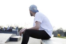 Skateboarder Hanging Out In Sk...