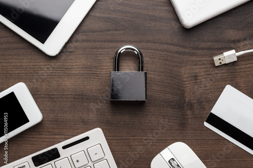 Photo  padlock and different gadgets on the wooden office table