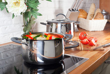 Pan On The Stove With Vegetables In Kitchen Interior