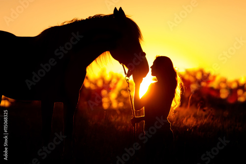 Foto op Canvas Paarden Beautiful silhuette of girl and horse at sunset
