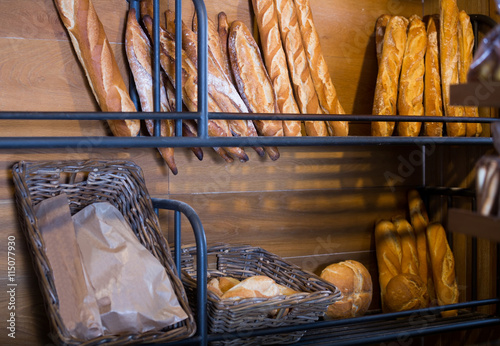 obraz dibond French baguettes in shelves of bakery