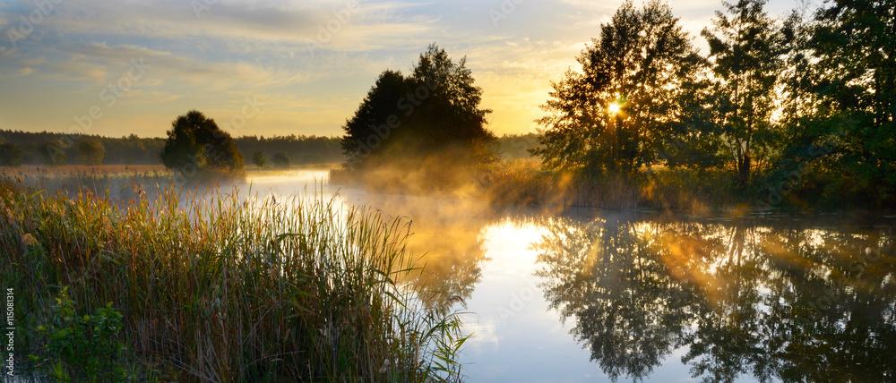 Fototapeta Sunset over river