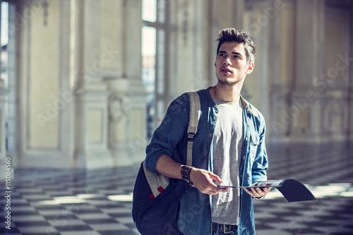 Fotografía  Handsome Man Holding a Guide Inside a Museum