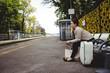 Full length of woman waiting at railroad station