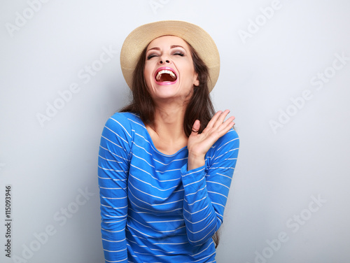 Fotografie, Obraz  Laughing young woman in straw hat with closed eyes and hand near