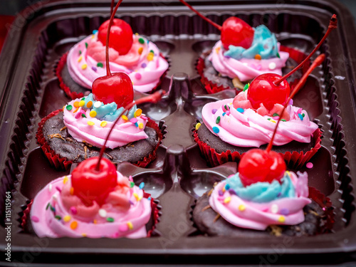 fototapeta na lodówkę Blue-Purple Vegan Cupcakes with Cherry on Top