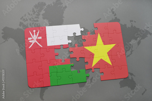 puzzle with the national flag of oman and vietnam on a world ...