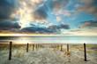 Leinwandbild Motiv sunset over North sea coast