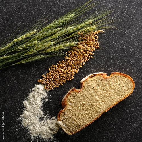 fototapeta na szkło Ears of corn, grain and flour rye lie on tile