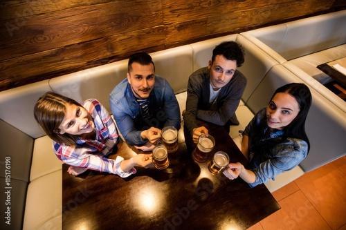 Friends enjoying beer at restaurant Canvas