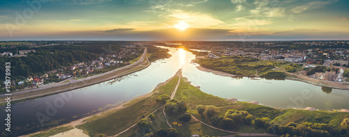 Poster Olive Aerial image of Kaunas city, Lithuania. Summer sunset scene
