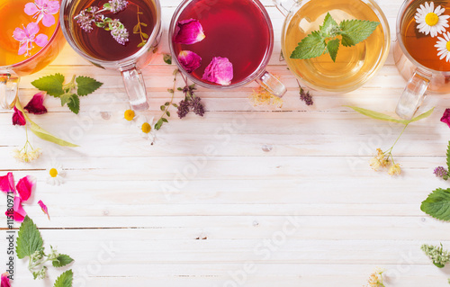Fototapety, obrazy: herbal tea on a white wooden background