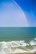 Colorful Rainbow over the Beach Shoreline