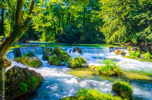 Fototapeta view of a creek in the English garden in Munich, Bayern, Germany