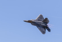 F-22 Raptor In Flight With Vap...