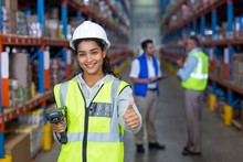 Smiling Female Worker With Thumb Up