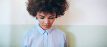 Pensive Young Woman Looking Down