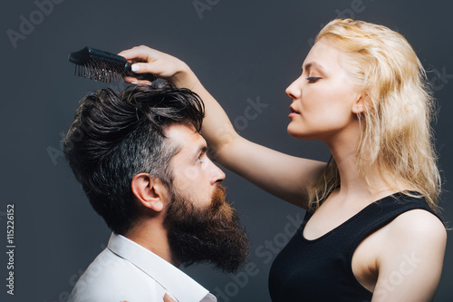 fototapeta na drzwi i meble blonde hairdresser combing bearded man