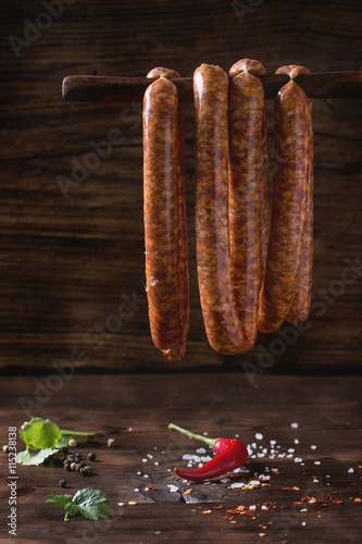 obraz dibond Raw sausages for BBQ