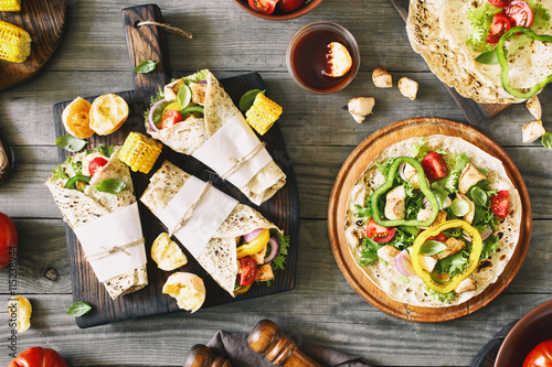 Fotografie, Obraz  Roll tortilla with grilled chicken fillet and grilled vegetables