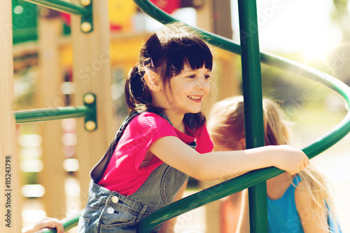 obraz dibond group of happy little girls on children playground