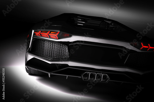 Photo  Black fast sports car in spotlight, black background