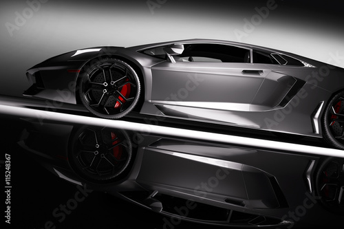 Grey fast sports car in spotlight, black background. Shiny, new, luxurious.