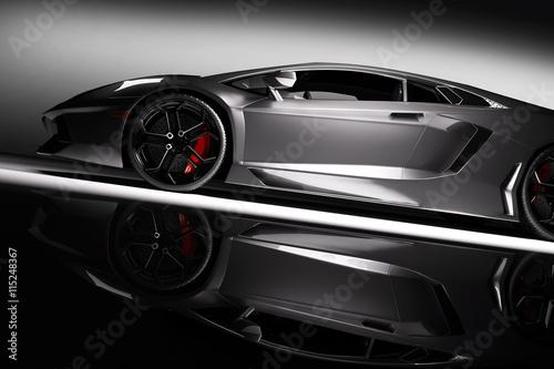 fototapeta na lodówkę Grey fast sports car in spotlight, black background. Shiny, new, luxurious.