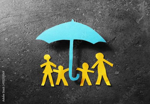 Fotografering  Paper family under umbrella