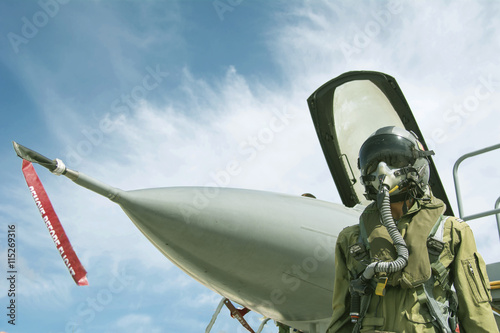 Pilot with suit and militar...