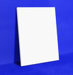 canvas print picture - Blank white poster canvas frame leaning at vivid blue concrete p