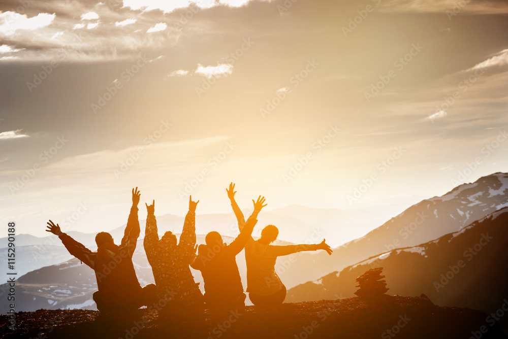 Fototapety, obrazy: Group of friends sits on the top of mountain and having fun on mountains backdrop