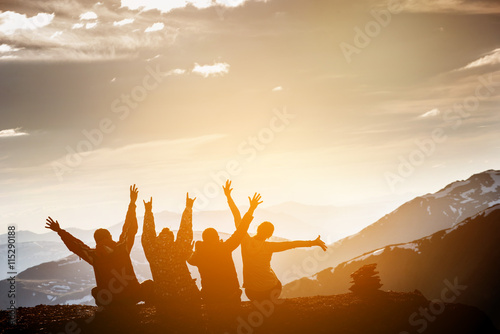 canvas print motiv - cppzone : Group of friends sits on the top of mountain and having fun on mountains backdrop